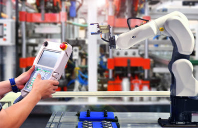 engineer-check-control-automation-robot-arm-machine-automotive-bearings-packing-process-factory_67340-173